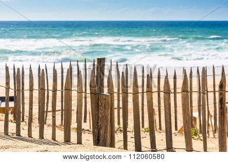 Wooden Fence On An Atlantic Beach In France