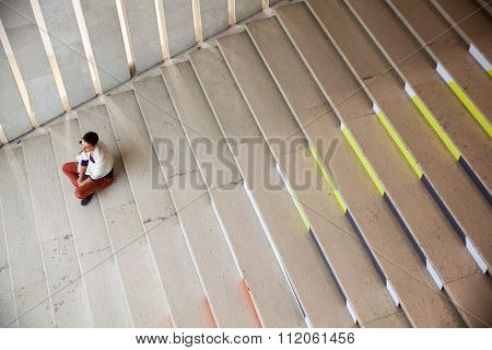 Girl Sitting On Staircase