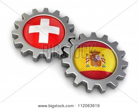 Swiss and Spanish flags on a gears. Image with clipping path
