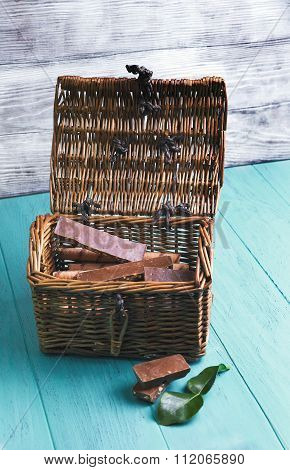 Cart-chest With Pieces Of Chocolate With Nuts And Wafer Rolls