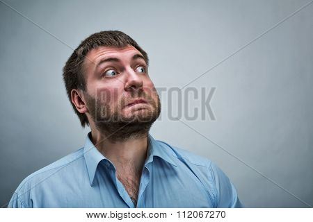 Frightened businessman wearing blue shirt over grey