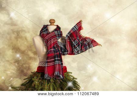 Tartan scarf on vintage mannequin dressed for winter