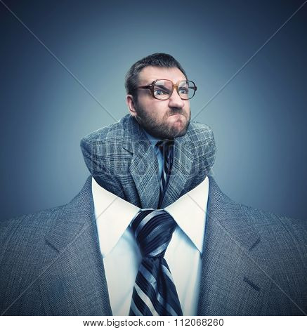 Businessman headshot with little angry businessman instead of head