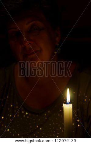 Middle Aged Woman With Candle