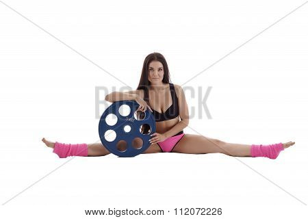 Attractive sportswoman with disk from barbell