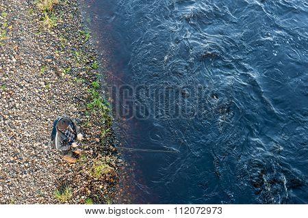 Angler Fishing For Salmon On River Deveron.