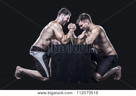 Two sportsmen armwrestling