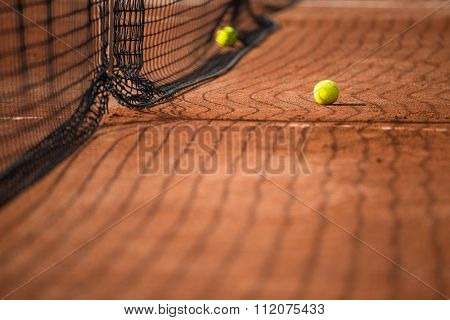 Tennis court with tennis balls and the net