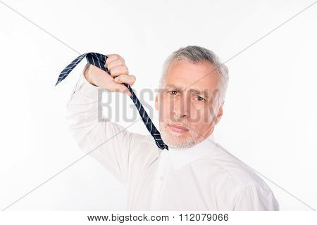 Old Depressed Businessman Choking Himself With Tie