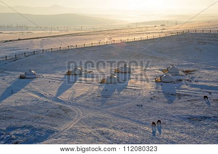 Mongolian Steppe With Yurt Camp In Winter Evening. Top View From Genghis Khan Equestrian Statue