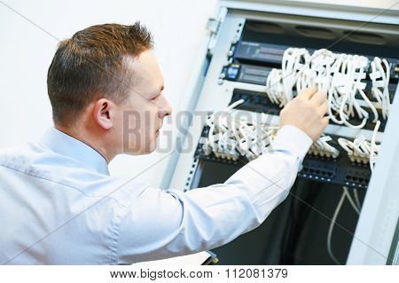 Networking service. network engineer administrator checking server hardware equipment of data center