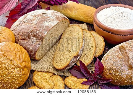 Bread and biscuits amaranth with flour and flower on board