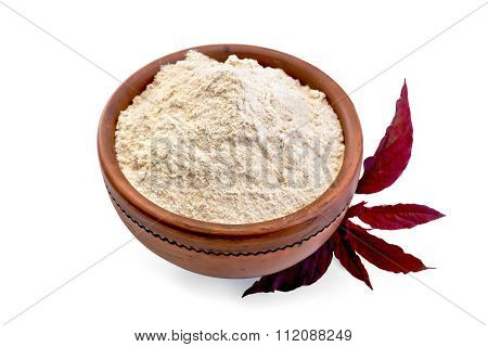 Flour amaranth in clay bowl with a flower