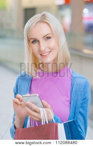 Pleasant woman having shopping