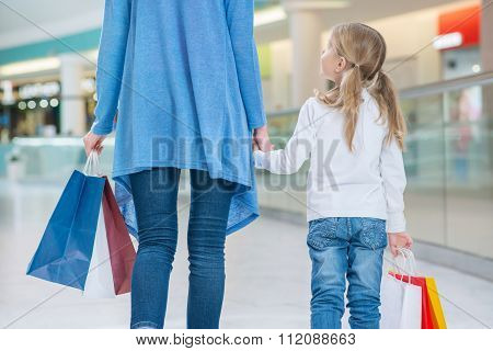 Cheerful mother and daughter having shopping