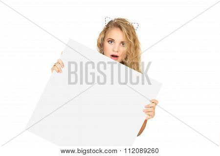 Young Woman Peeking From Behind The Advert