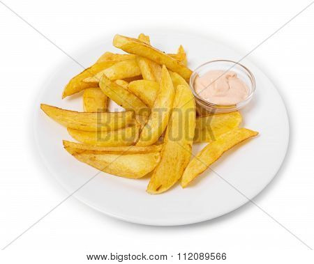 Delicious potato wedges with sauce.