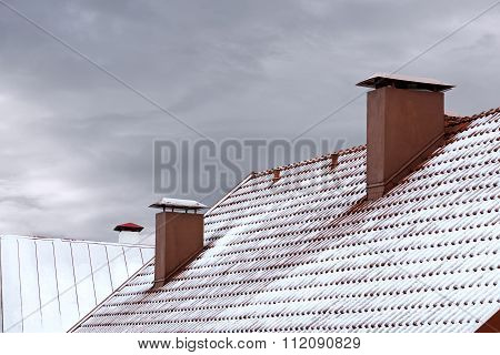 Roof Of House Covered With Snow