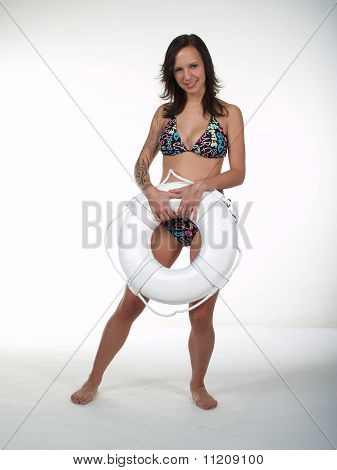 Girl In Bikini With Life Preserver Over White