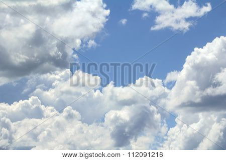 In The Blue Sky Floating Cumulus Clouds