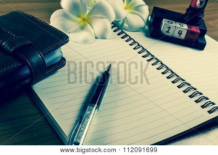 Pen And Leather Bag On Notebook During Valentine Day