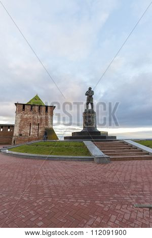 Nizhny Novgorod, Russia - November 11 2015. View of  Kremlin's St. George Tower and a monument to  p