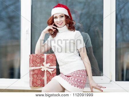 New Year, Christmas, X-mas Celebration And Concepts. Positive And Smiling Caucasian Red-haired Woman