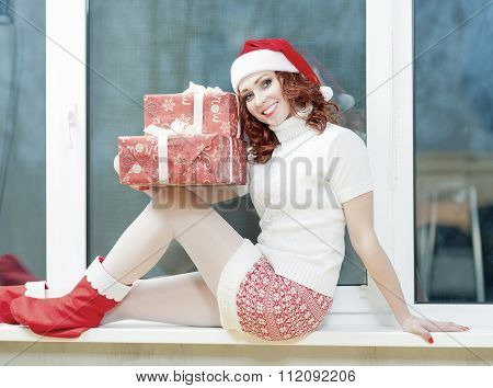 Christmas, New Year, X-mas Celebration And Concepts. Positive And Smiling Caucasian Red-haired Woman
