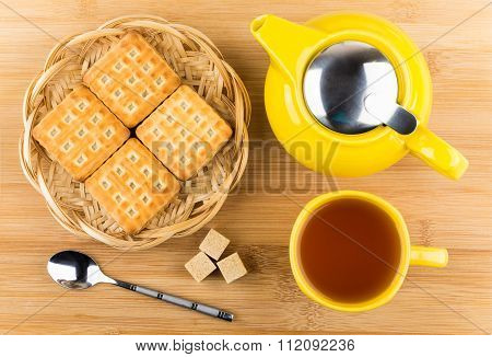 Cup Of Tea, Biscuits And Sugar Cubes On Wooden Table