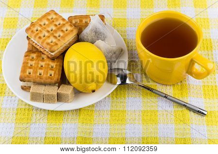 Cup Of Tea, Biscuits And Lemon In Plate