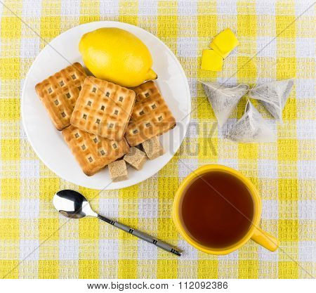Cup Of Tea, Biscuits And Lemon In Plate On Table