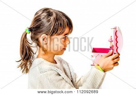 Happy Little Girl Listening The Music From Music Box With Ballerina Isolated On White