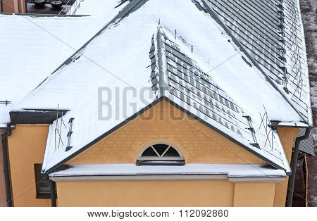 Snow On The Roof Of House