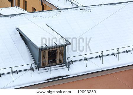 Dormer On Snowy Roof