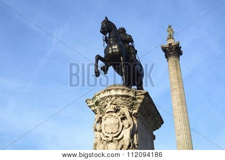 Statue of King Charles I in Trafalgar Square with Nelson's Column in the background.
