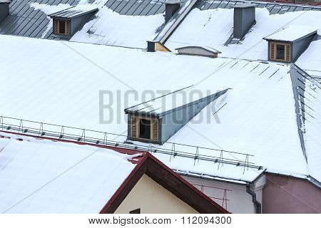 Snowy Metal Roof With Dormer