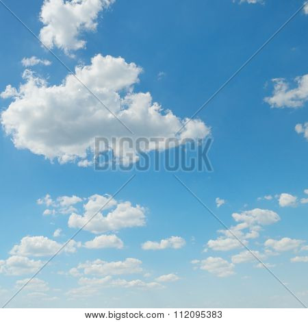 White Cumulus Clouds Against The Blue Sky