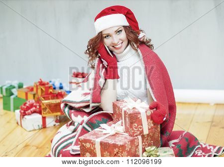 Christmas And New Year Celebration And Concepts. Happy Looking Red-haired Caucasian Woman In Santa H