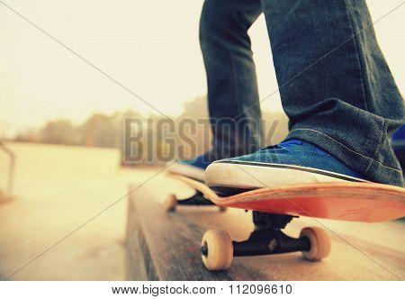 skateboarder legs skateboarding at skate park