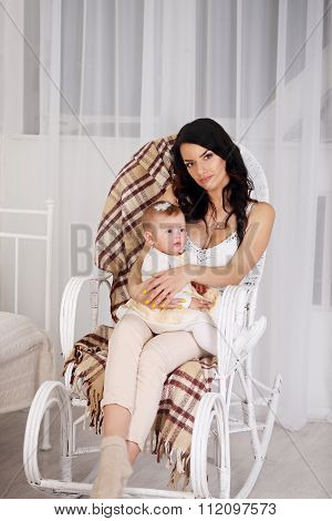 portrait of mother and daughter in the rocking chair