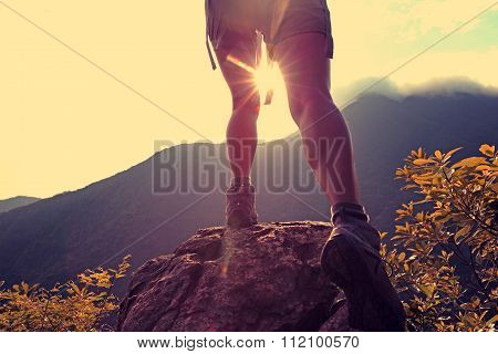 hiker hiking on mountain peak enjoy the view