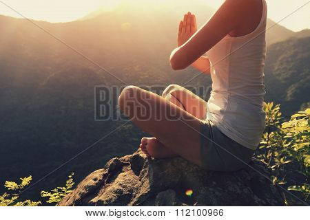 young fitness woman practice yoga on sunrise mountain peak
