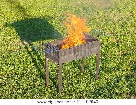 Firing Barbecue After Blazing Of Firestarter Liquid