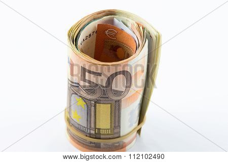 Fifty Euro rolled up on white background