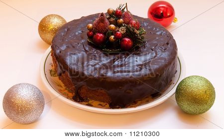Christmas cake with decoration balls.
