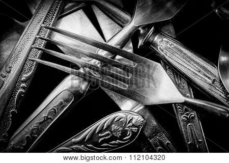 Abstract Black And White Photo Of Mixed Silver Forks, Spoons And Knives