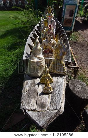 Anchorite And Hermit Figure Series In A Wooden Boat