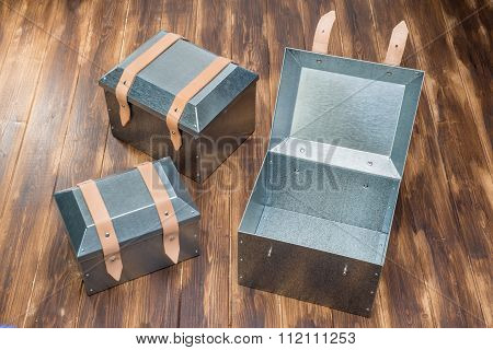 Three Metal Tool Box On Wooden Table