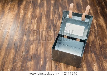 Metal Box In Side Of Metal Box On Wooden Table