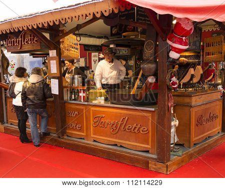 The Salesman Of La Defense Christmas Market, Paris, France.
